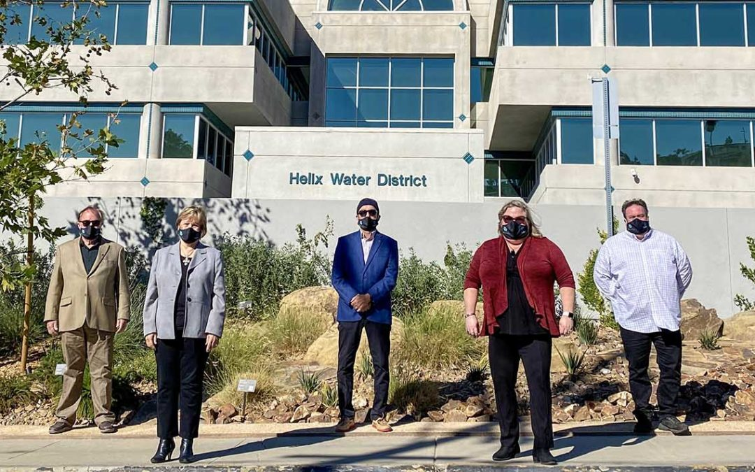 Photo shows Helix Water District Board of Directors standing in front of the district's administration office with their masks on in December 2020.
